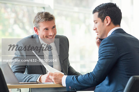 Businessmen discussing documents in meeting Stock Photo - Premium Royalty-Free, Image code: 632-08001604