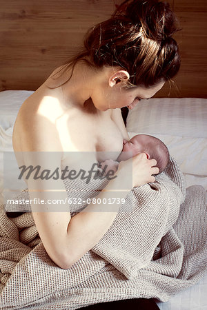 Mother breastfeeding newborn baby Stock Photo - Premium Royalty-Free, Image code: 632-08001739