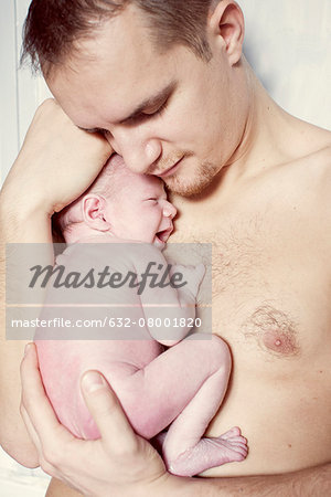 Father comforting crying newborn baby Stock Photo - Premium Royalty-Free, Image code: 632-08001820