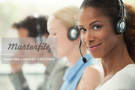 Telemarketer working in call center Stock Photo - Premium Royalty-Free, Image code: 632-08001865