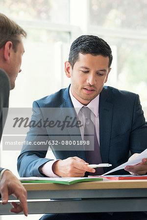 Businessman discussing contract with client Stock Photo - Premium Royalty-Free, Image code: 632-08001898