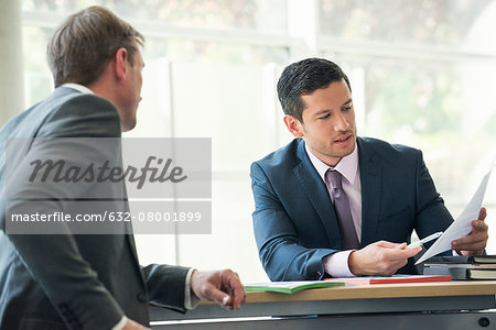 Businessmen discussing contract in meeting Stock Photo - Premium Royalty-Free, Image code: 632-08001899
