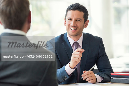 Businessman meeting with client Stock Photo - Premium Royalty-Free, Image code: 632-08001901