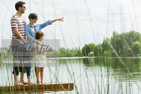 Family standing on dock looking into distance Stock Photo - Premium Royalty-Free, Image code: 632-08129813