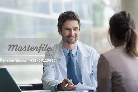 Doctor meeting with patient Stock Photo - Premium Royalty-Free, Image code: 632-08129860
