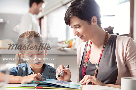 Mother and young daughter reading together Stock Photo - Premium Royalty-Free, Image code: 632-08129922