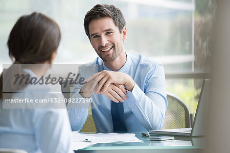 Insurance agent meeting with prospective customer Stock Photo - Premium Royalty-Free, Image code: 632-08227390