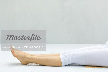 Woman with legs outstretched, barefoot, low section Stock Photo - Premium Royalty-Free, Image code: 633-02345910