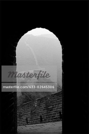 Looking out from arched doorway of room perched atop Great Wall of China Stock Photo - Premium Royalty-Free, Image code: 633-02645306