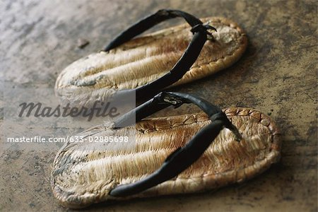 Pair of straw sandals Stock Photo - Premium Royalty-Free, Image code: 633-02885698