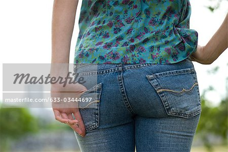 Woman wearing tight jeans, close-up of buttocks Stock Photo - Premium Royalty-Free, Image code: 633-03444697