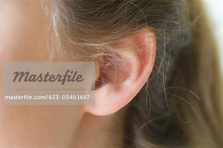 Close-up of young woman's pierced ear Stock Photo - Premium Royalty-Free, Image code: 633-05401667