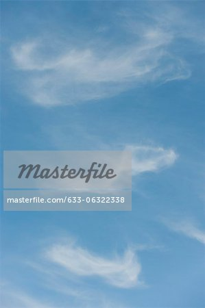 Wispy clouds in sky Stock Photo - Premium Royalty-Free, Image code: 633-06322338