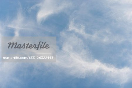 Wispy clouds in sky Stock Photo - Premium Royalty-Free, Image code: 633-06322443