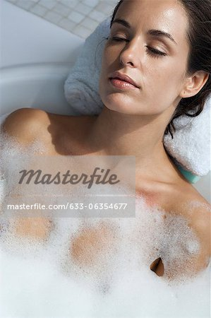 Woman relaxing in bubble bath Stock Photo - Premium Royalty-Free, Image code: 633-06354677