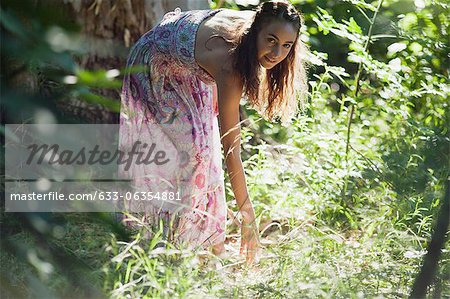 Young woman in woods Stock Photo - Premium Royalty-Free, Image code: 633-06354881