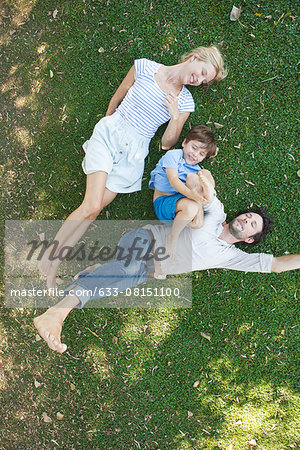 Young family with boy lying together on grass Stock Photo - Premium Royalty-Free, Image code: 633-08151100