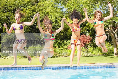 Four teenage girls jumping into pool Stock Photo - Premium Royalty-Free, Image code: 635-01347879