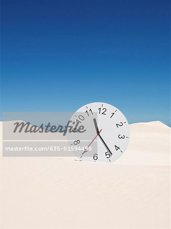 An oversized clock in the middle of a desert Stock Photo - Premium Royalty-Free, Image code: 635-01594499