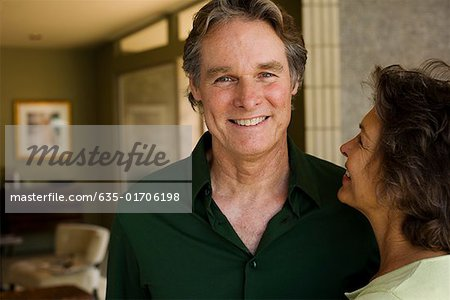 Couple standing in modern home Stock Photo - Premium Royalty-Free, Image code: 635-01706198