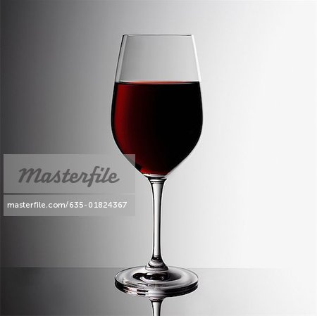 Glass of red wine indoors Stock Photo - Premium Royalty-Free, Image code: 635-01824367