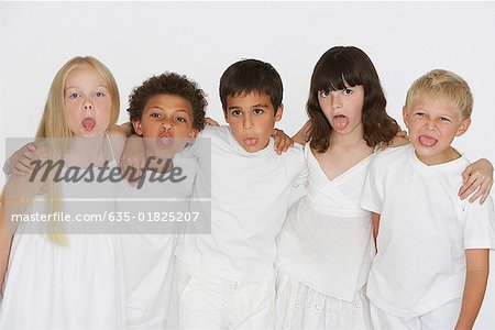 Five young children indoors sticking tongues out at camera Stock Photo - Premium Royalty-Free, Image code: 635-01825207