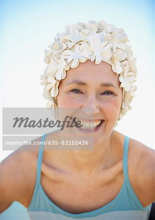 Mature woman in old-fashioned swim cap on beach Stock Photo - Premium Royalty-Free, Image code: 635-02152436