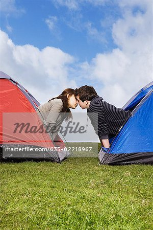 Couple kissing in tents Stock Photo - Premium Royalty-Free, Image code: 635-02218967