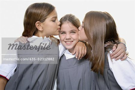 School girls kissing friend Stock Photo - Premium Royalty-Free, Image code: 635-02312882