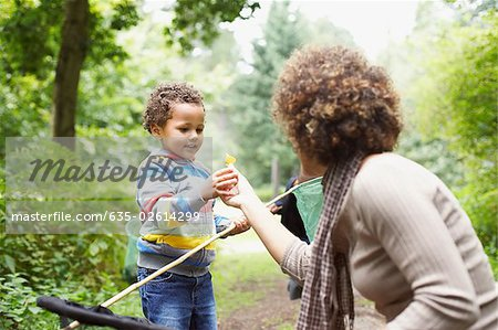 Mother and son exploring park Stock Photo - Premium Royalty-Free, Image code: 635-02614299