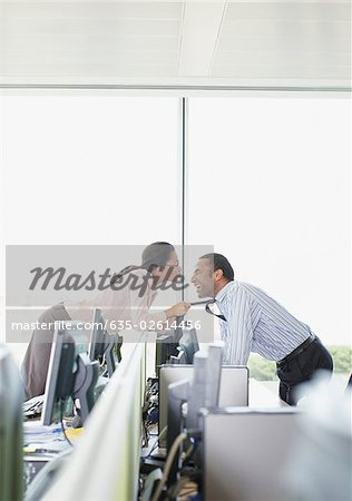 Businesswoman kissing co-worker in office Stock Photo - Premium Royalty-Free, Image code: 635-02614456