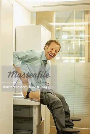 Businessman photocopying his buttocks Stock Photo - Premium Royalty-Free, Image code: 635-02614523