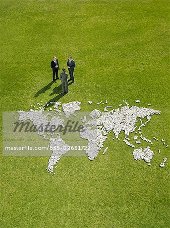 Businesspeople meeting near world map made of rocks Stock Photo - Premium Royalty-Free, Image code: 635-02681722