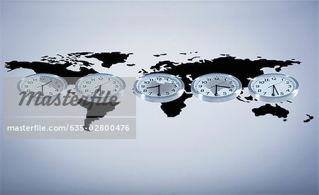 Time zone clocks on world map Stock Photo - Premium Royalty-Free, Image code: 635-02800476