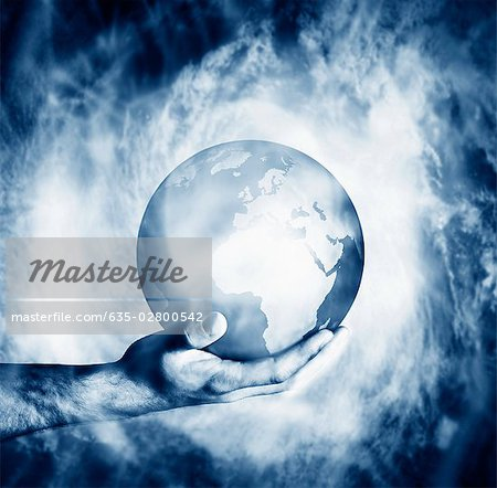 Man holding globe clouded in mist Stock Photo - Premium Royalty-Free, Image code: 635-02800542