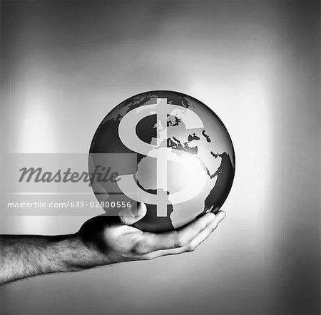 Man holding globe with dollar symbol Stock Photo - Premium Royalty-Free, Image code: 635-02800556