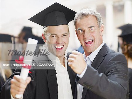 Father and graduate son celebrating Stock Photo - Premium Royalty-Free, Image code: 635-03228722