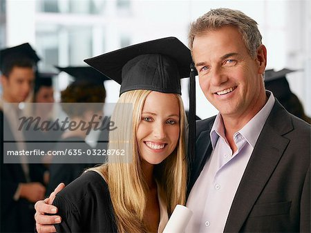 Father and graduate daughter hugging Stock Photo - Premium Royalty-Free, Image code: 635-03228762