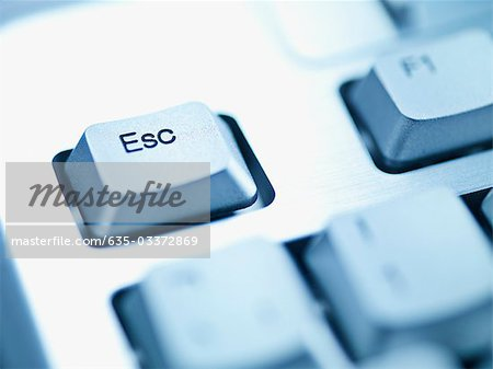 Computer keyboard escape key Stock Photo - Premium Royalty-Free, Image code: 635-03372869