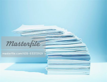 Stack of paper piled precariously Stock Photo - Premium Royalty-Free, Image code: 635-03372919