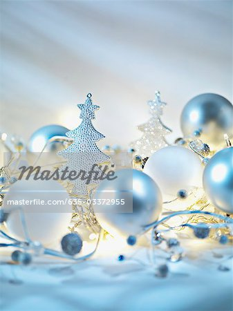 Christmas ornaments and string light Stock Photo - Premium Royalty-Free, Image code: 635-03372955