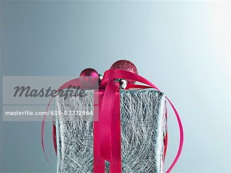 Christmas gift with red ribbon and silver wrapping Stock Photo - Premium Royalty-Free, Image code: 635-03372964