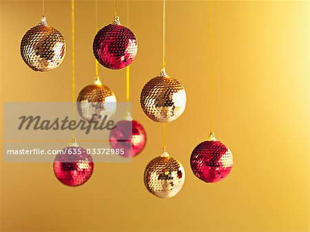 Christmas ornaments hanging from string Stock Photo - Premium Royalty-Free, Image code: 635-03372985