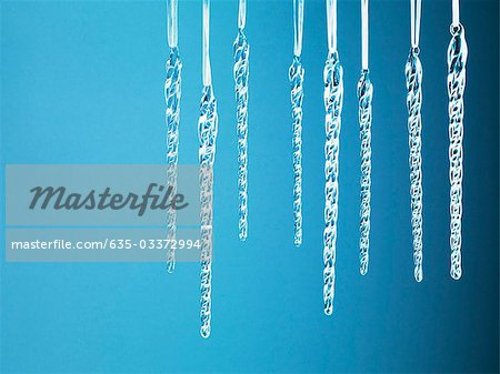 Icicle Christmas ornaments hanging from string Stock Photo - Premium Royalty-Free, Image code: 635-03372994