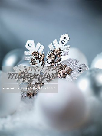 Close up of snowflake Christmas ornament Stock Photo - Premium Royalty-Free, Image code: 635-03373047