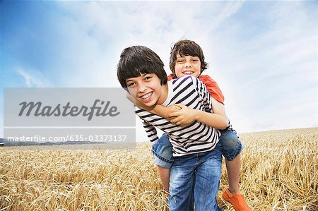 Boys playing in wheat field Stock Photo - Premium Royalty-Free, Image code: 635-03373137