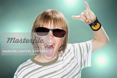 Boy with sunglasses making horn gesture Stock Photo - Premium Royalty-Free, Image code: 635-03373306