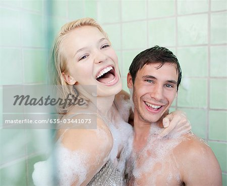 Couple in bathtub covered with soap suds Stock Photo - Premium Royalty-Free, Image code: 635-03441073