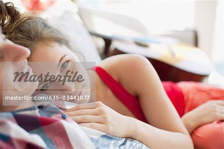 Couple laying on sofa Stock Photo - Premium Royalty-Free, Image code: 635-03441077