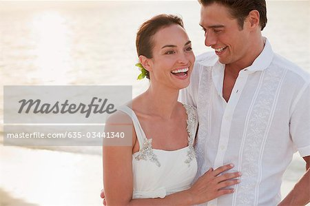 Bride and groom on beach Stock Photo - Premium Royalty-Free, Image code: 635-03441340